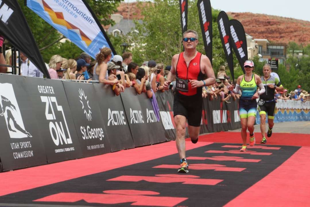 Ed Dressel running and competing in an Ironman Triathlon in 2021